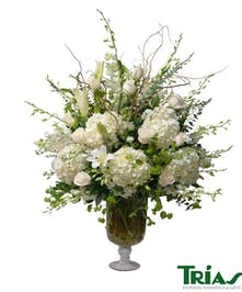 Elegant arrangement with orchids, roses, lilies and hydrangeas