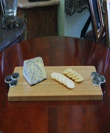 Wood serving tray with pewter handles.