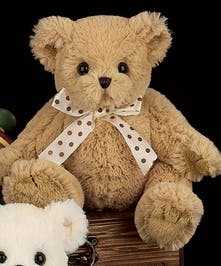 A caramel colored stuffed teddy bear from the Bearington Bear Collection