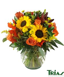 Orange roses, sunflowers and autumn accents