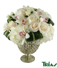 Elegant silver vase  with orchids, roses and hydrangeas