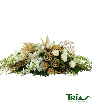 Holiday centerpiece with christmas decor and flower varieties