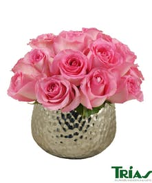 Silver hammered vase with pink roses.
