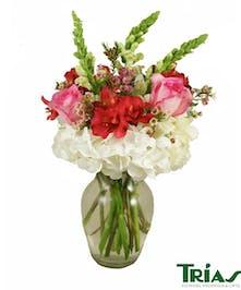 White hydrangeas, pink roses, pink alstromerias and white snapdragon.