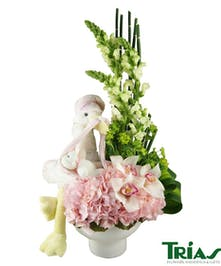 Fresh pink & white blooms with a special delivery stork.
