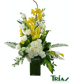Yellow and white arrangement of roses, orchids,calla lilies  and more