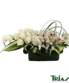 Modern & elegant white roses & orchids design