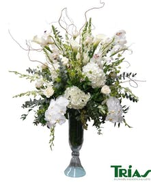 Elegant tall clear glass vase with mixed flowers inlcuding orchids, roses, calla lilies and more.