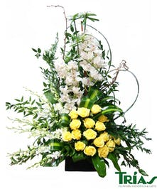 Modern design with yellow roses & orchids