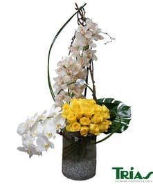 Bright yellow and white beauty with roses and orchids!