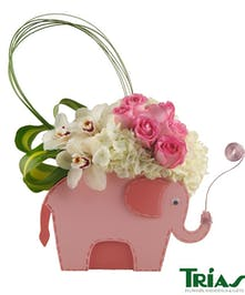 PInk and white flowers in an elephant keepsake box