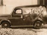One of our earliest delivery vans, painted with the Trias insignia, from the early 20th century