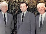 Joaquin and two forefathers, dressed in business suits, circa 1967